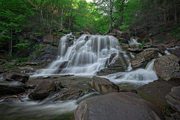using filters - A polarizer can reduce the reflected light from wet rocks.
