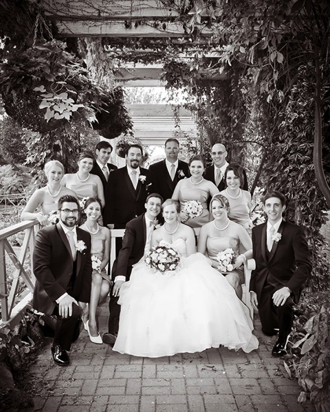 Wedding party posed garden