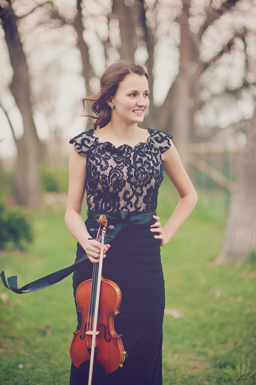 musician standing with a violin