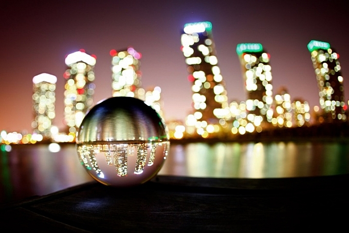 Doing Crystal Ball Refraction Photography - The image inside the ball will be upside down.