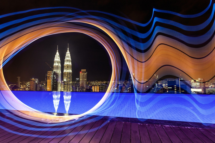 The petronas towers in Kuala Lumpur are framed using light from the pixelstick, adding a lot of interest to this photo.