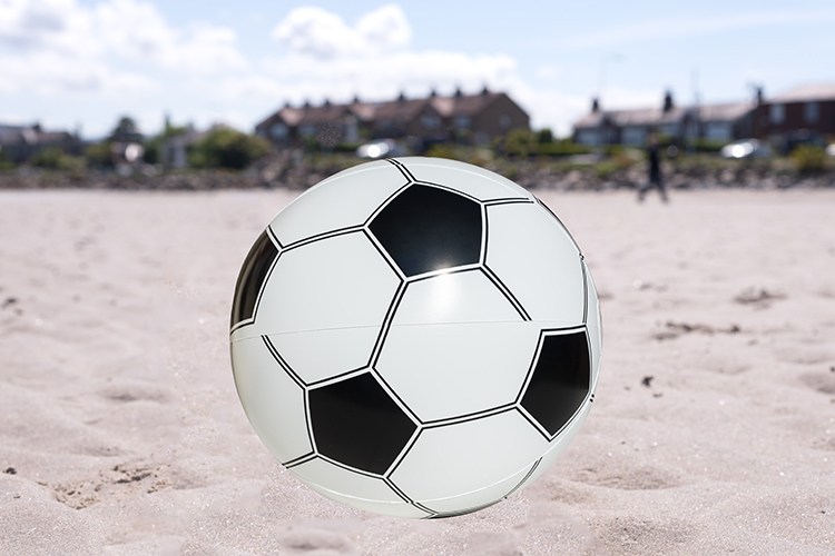 cut-out-ball-on-beach