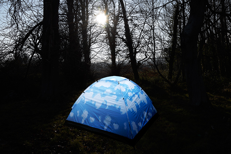 A tent cut out using the Pen Tool in Photoshop and place against a different background.