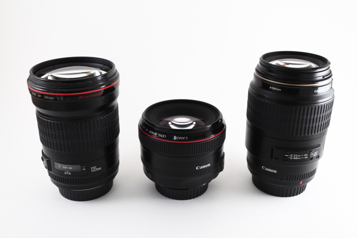 three Canon lenses