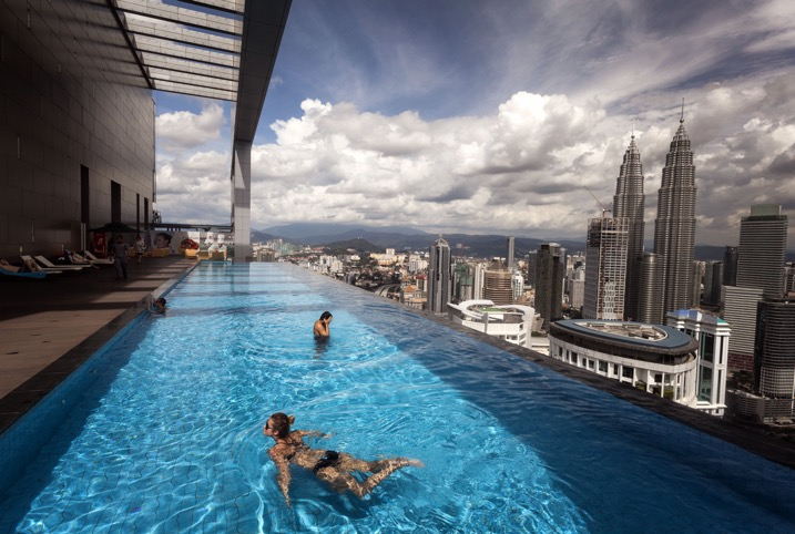 people swimming in rooftop pool