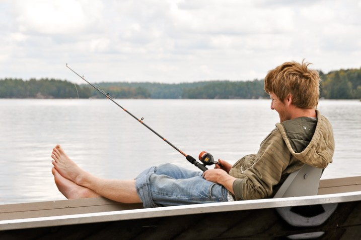 A man fishing, in a photo that has been taken to capture the mood and emotion of the scene.