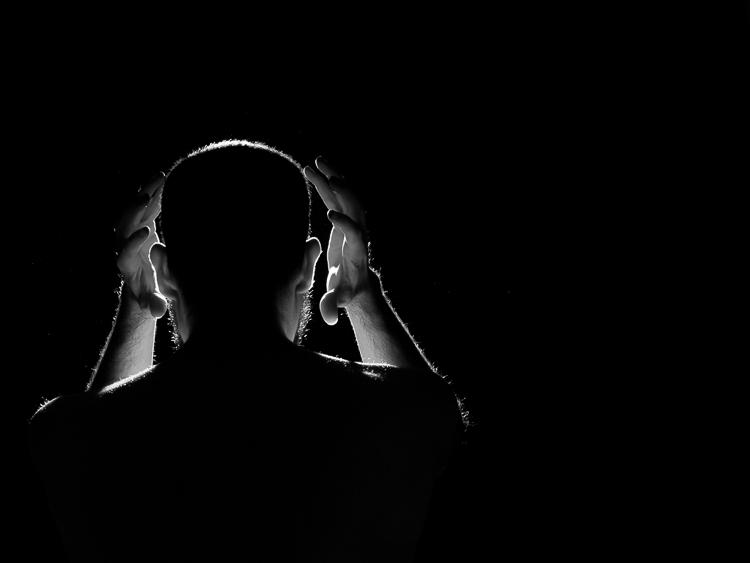 rim light photography man with hands around head