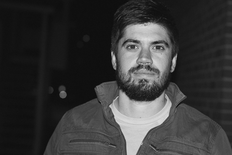 A photo of a man taken using on-camera flash to illustrate the lack of depth and shadow that occurs with this technique - How to Use a Cell Phone for Dramatic Night Photography