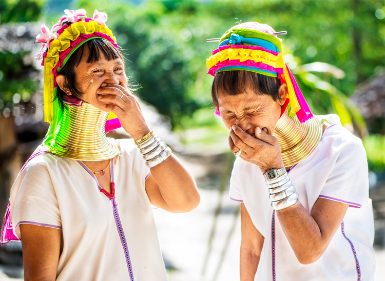 Two long neck Kayan ladies laughing together in a village in Thailand - How to Use a Reflector