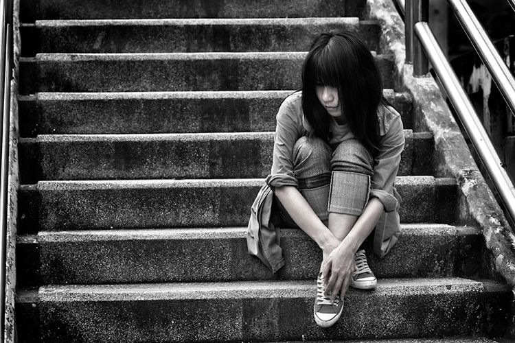 Asian woman sitting on an outdoor staircase - 5 Key Elements that Directly Impact the Quality of Your Photography