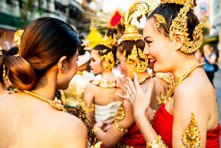 Women in traditional Thai costume prior to the start of the Flower Parade in Chiang Mai, Thailand - How to be Better Prepared for Your Next Photo Shoot