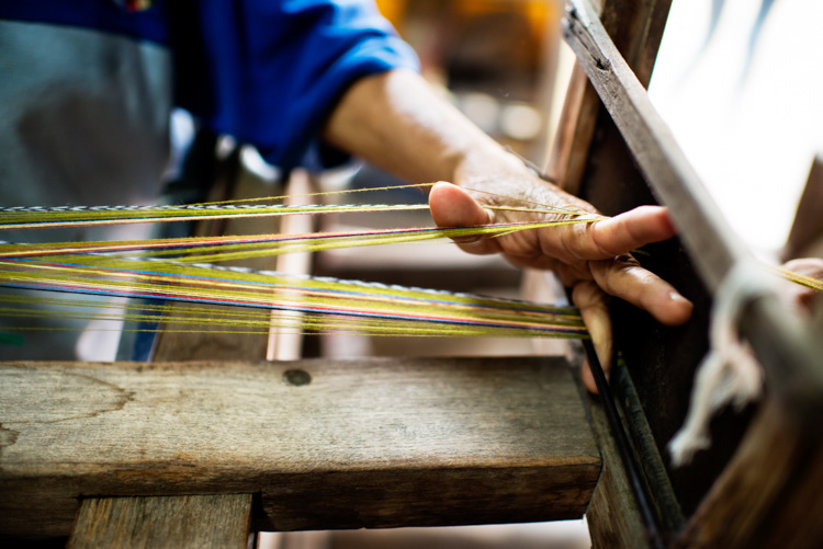 Preparing silk thread fo weaving. Why Volunteering is a Great Way to Grow as a Photographer