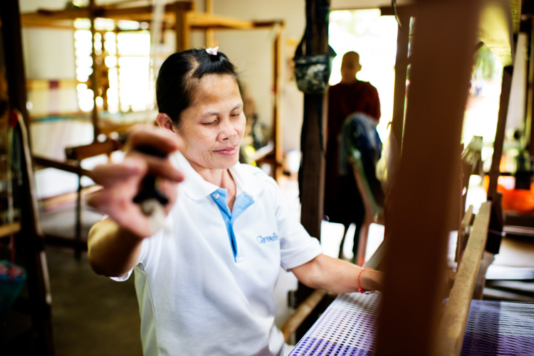 Women weaving silk on a traditional loom in northern Thailand. Why Volunteering is a Great Way to Grow as a Photographer