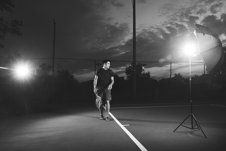 An example showing an off-camera flash cross lighting setup for a portrait of a tennis player.