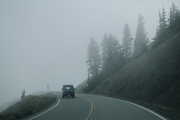Car in a foggy day along a ridge road - Rocking the Photography Equipment You Currently own Versus Buying New Gear