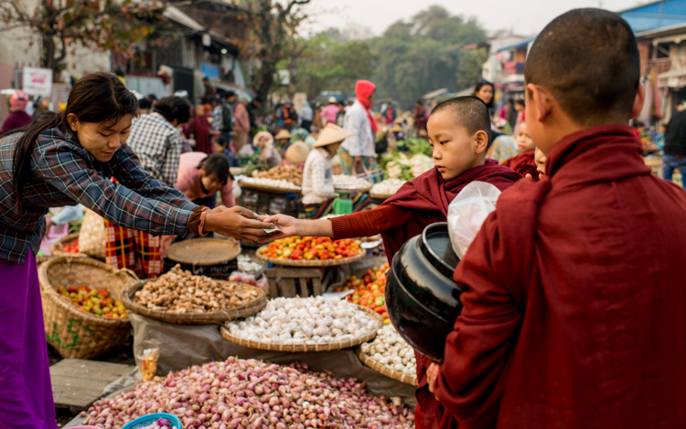 Young novice monks in a morning market in Mandalay, Myanmar - 3 Bad Habits to Break to Improve Your Photography
