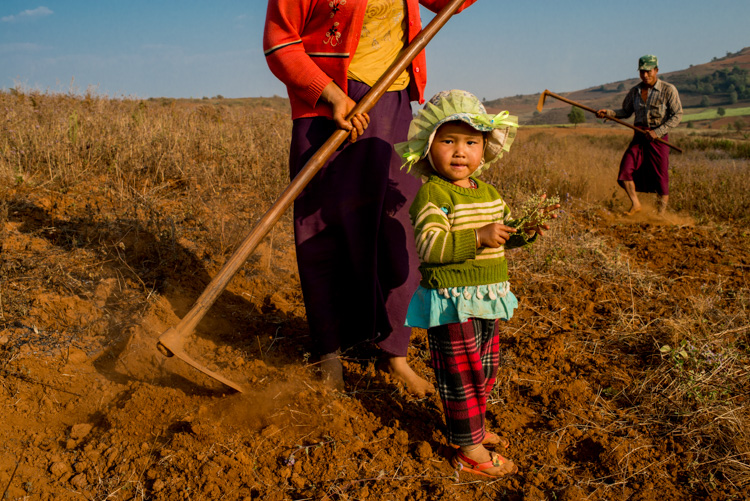 Parents and young daughter working in a field in Myanmar - 3 Bad Habits to Break to Improve Your Photography