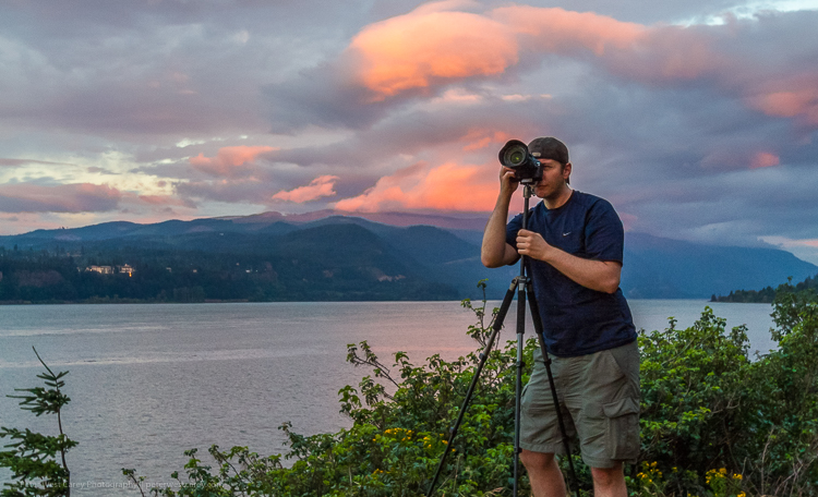Photographer and sunset - Tips for Making Your Travel Photography Packing List for International Trips
