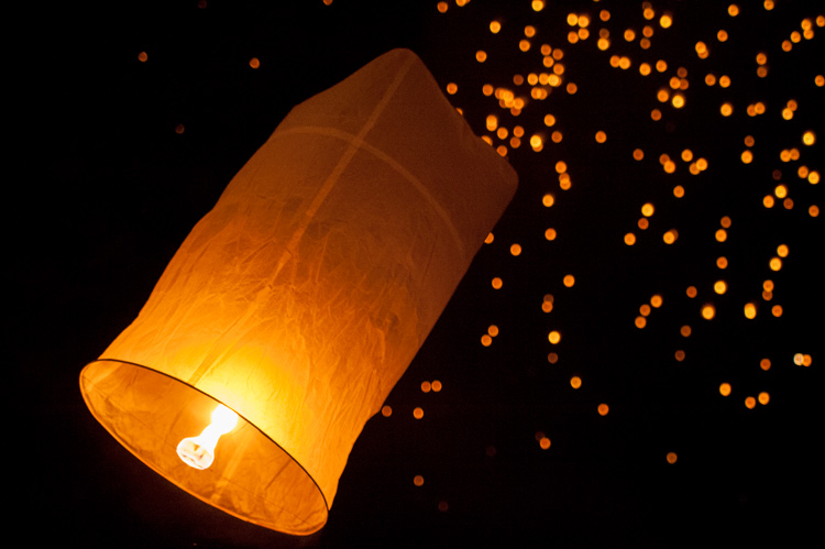 Sky lanterns being released in Chiang Mai during Yee Ping festival - high ISO