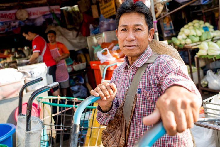 Thai man working as a porter at the fresh market in Chiang Mai - How Slow Photography Can Help You Improve Your Images