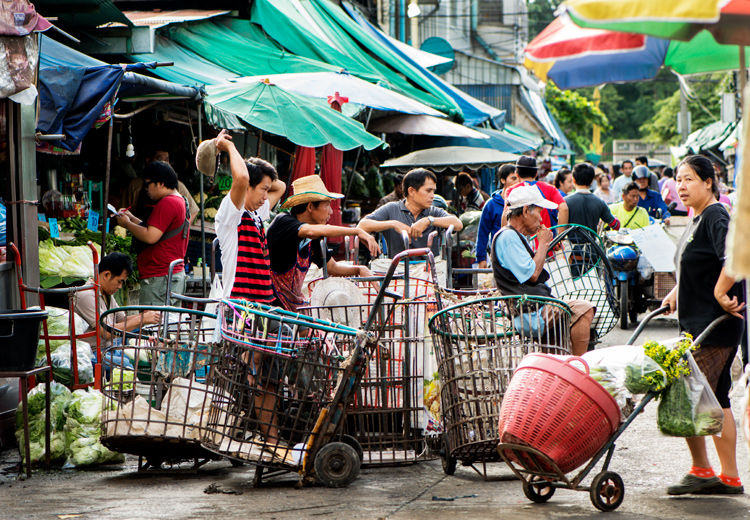 Street with activity in Muang Mai Market, Chiang Mai, Thailand. - How Slow Photography Can Help You Improve Your Images
