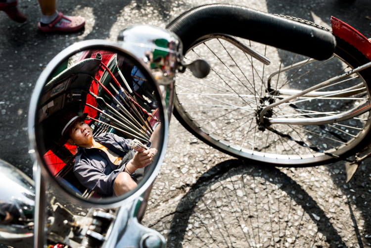 Reflection of a tricycle taxi rider in his bike mirror in Chiang Mai, Thailand. - 5 Tips To Help You Enjoy Your First Digital Camera