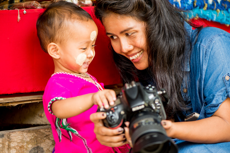 Thai woman and child share a fun moment with a DSLR camera in Chiang Mai, Thailand - 5 Tips To Help You Enjoy Your First Digital Camera