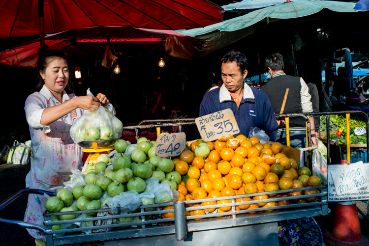 Woman selling fresh fruit at a market in Chiang Mai - Tips for Learning How to See the Light and Take Better Photos