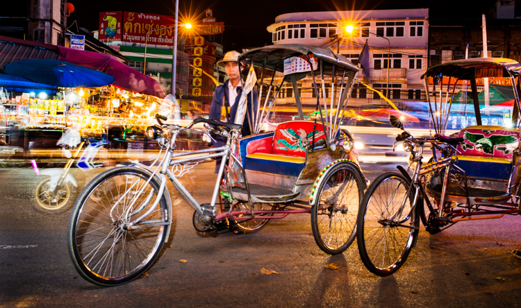 Tricycle Taxis at Night near Warorot Market in Chiang Mai, Thailand.