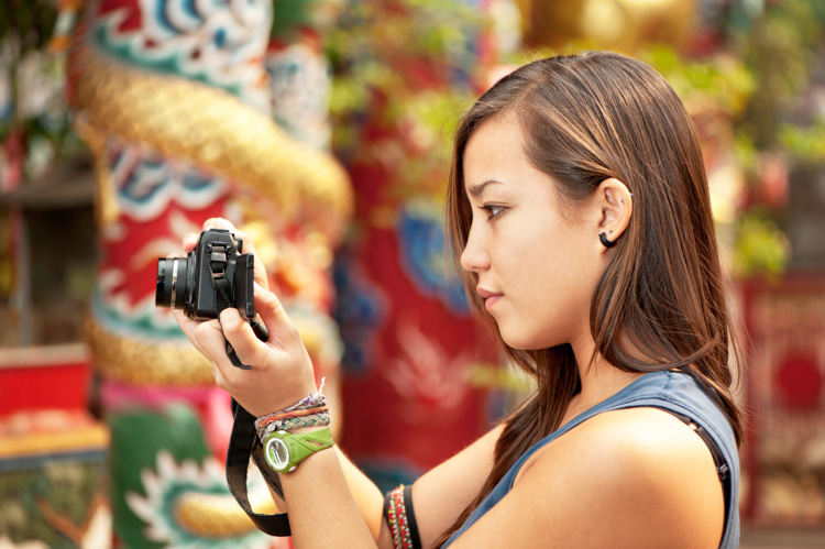 Asian woman taking a photo - all about ISO