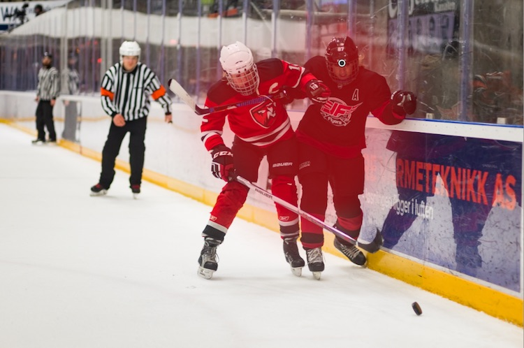 A hockey image with a adjustment brush applied to it - Tips for Editing Hockey Photos in Lightroom