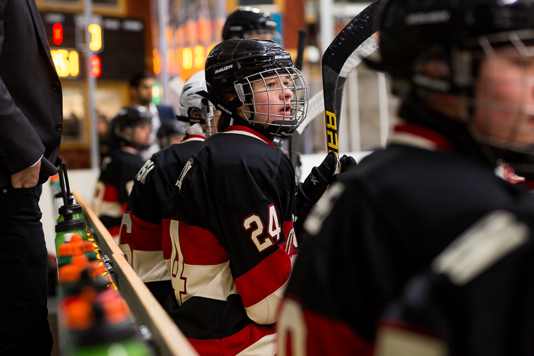 A hockey player on the bench during a game - Tips for Editing Hockey Photos in Lightroom