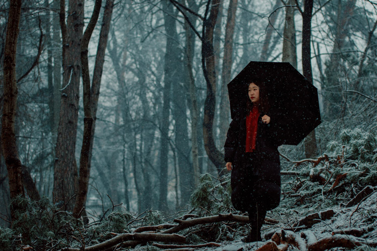 girl walking in the woods in winter - What keeps you from taking better photos, your EQUIPMENT or your KNOWLEDGE?