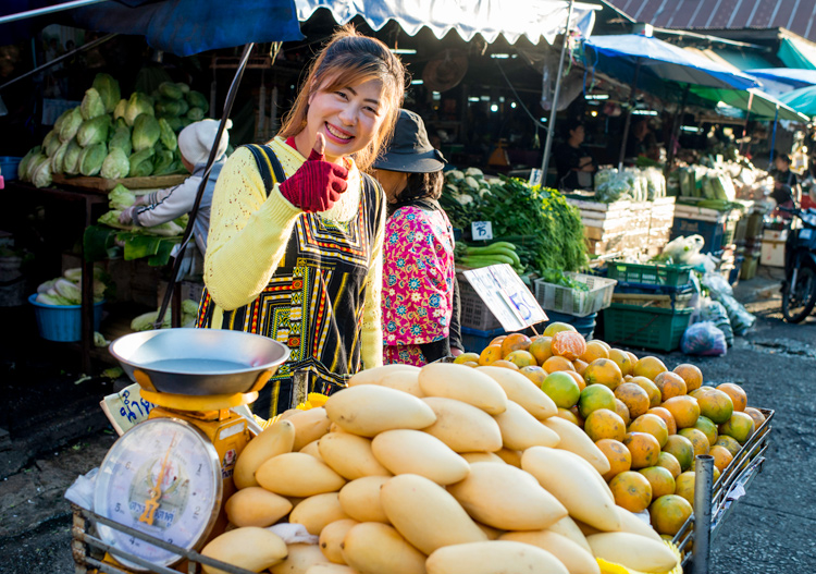 Woman selling mangoes - 4 Tips to Help You Love Using Manual Mode