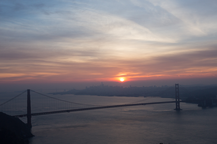 Golden Gate Bridge with a pink hue at sunrise before editing straight out of camera -