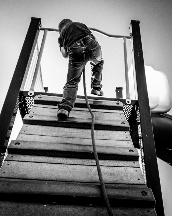 Climbing child on playground equipment - How Conquer Your Fear of People as a Photographer