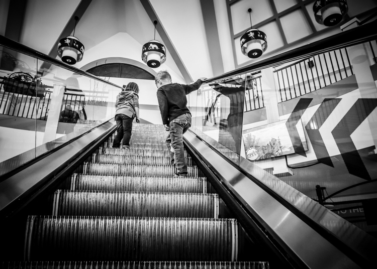 Riding the escalator. How Conquer Your Fear of People as a Photographer