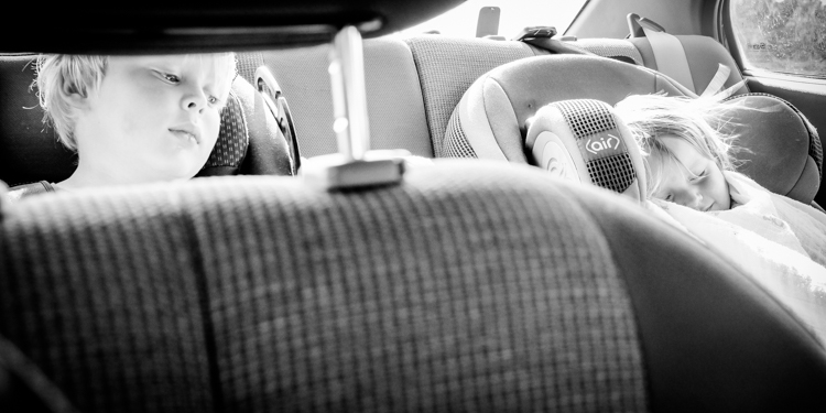 Two toddlers sleeping in the car. How to Photograph Your Family Vacation
