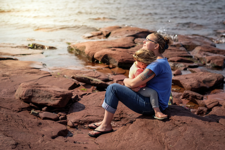 A little girl with sand in her eyes. How to Photograph Your Family Vacation