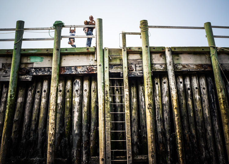 A family at a harbor. How to Photograph Your Family Vacation