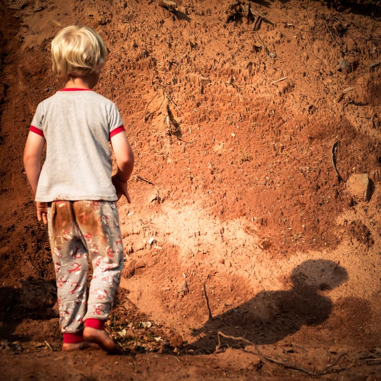 A boy playing in dirt. How to Photograph Your Family Vacation