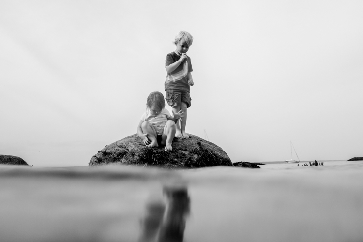 Kids on a rock in the ocean. - How to Photograph Your Family Vacation