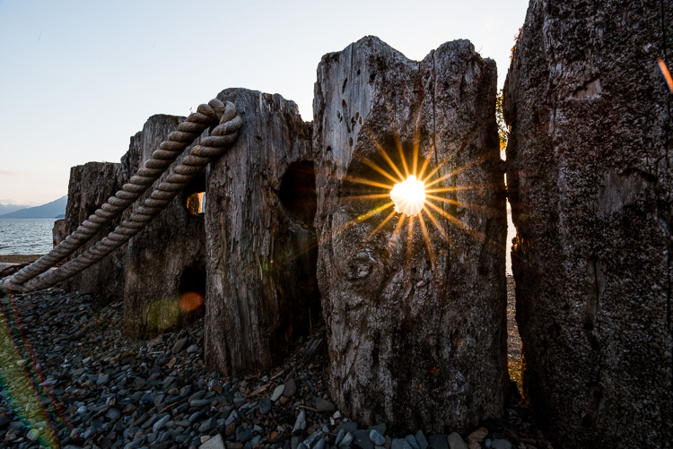 Review of the Sigma 14-24mm F2.8 Art Lens - sun burst between wooden pier
