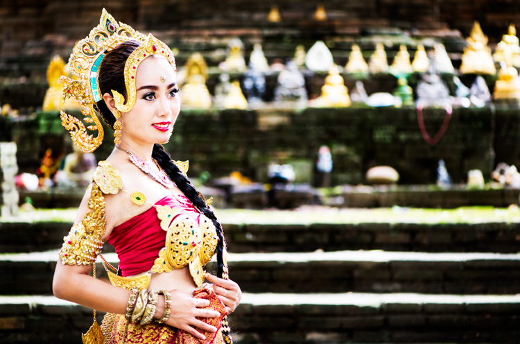Thai woman in traditional costume - improve your photography
