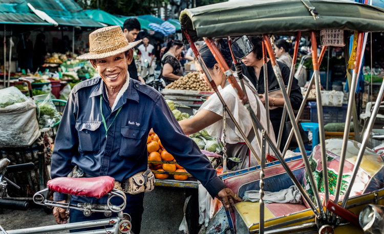 Tricycle taxi rider in a market in Chiang Mai - How to Find Inspiration for Your Photography