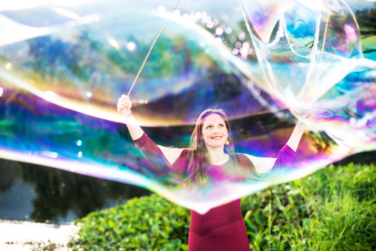 lady and giant soap bubbles - improve your photography