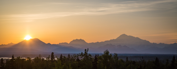 Tips for Shooting Landscapes With a Telephoto Lens - sunset over the mountains