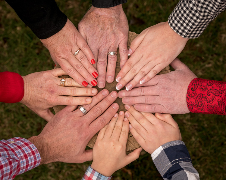 Why You Need to Manage Expectations - Both Yours and Your Client's - family photo of hands