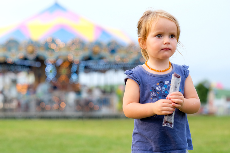 Portrait of a girl at a fair. family life