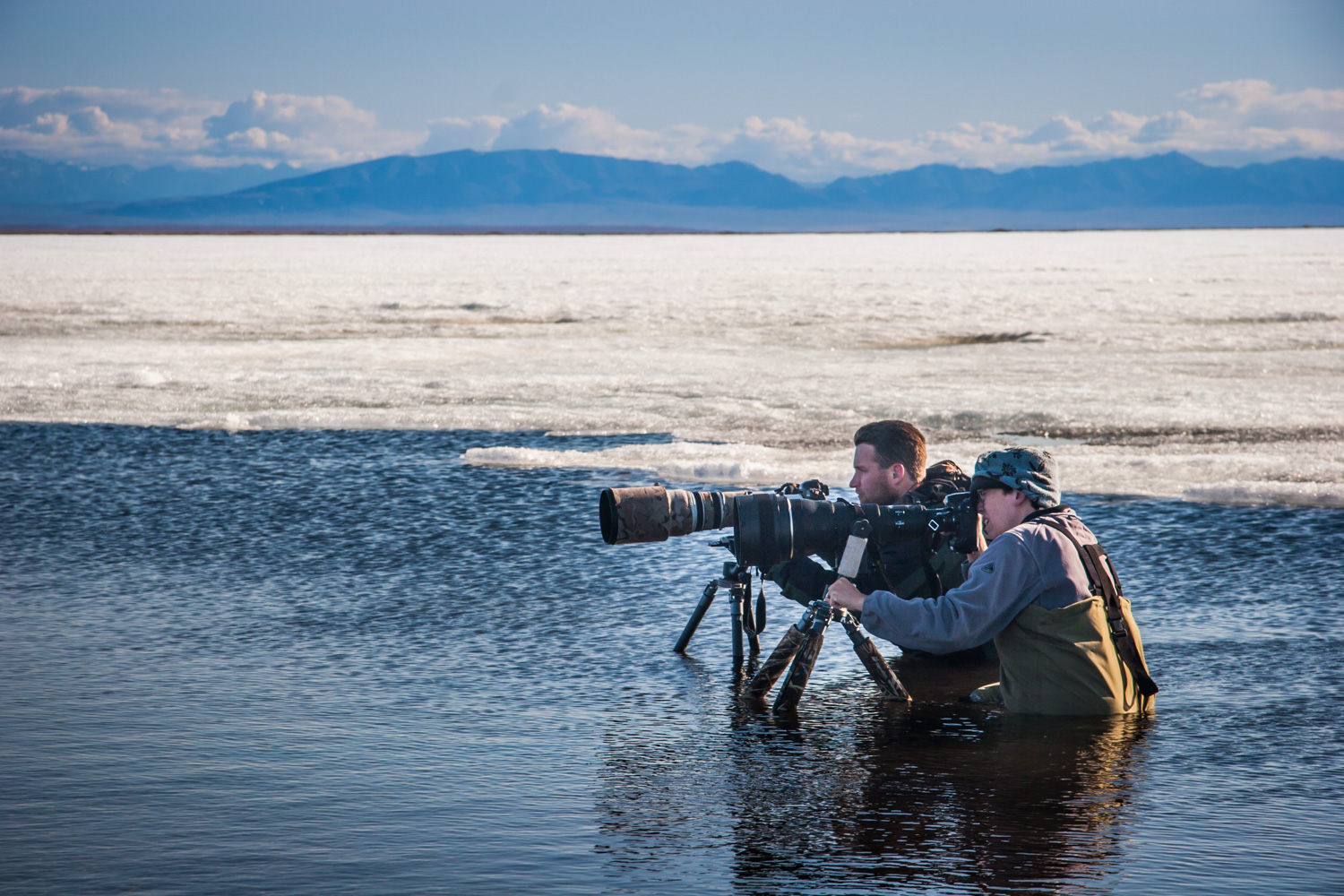 A Guide to Photographing Birds and Wildlife in a Wetland Area - 2 photographers with big lenses in the water